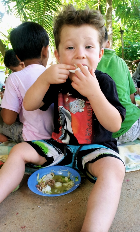 Beau having his fourth bowl of chicken soup on a school excursion to a nearby village